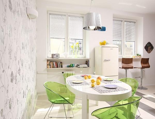 Kuchnia otwarta - owalny, biały stół kuchenny
